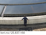 Купить «Biological wastewater treatment is carried out in aeration tanks of propellant, worker stands near primary settler», фото № 25837150, снято 19 марта 2015 г. (c) Losevsky Pavel / Фотобанк Лори