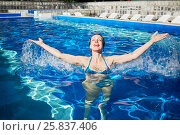 Купить «Young woman enjoying in outdoor swimming pool at summertime», фото № 25837406, снято 23 июня 2015 г. (c) Losevsky Pavel / Фотобанк Лори