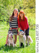Купить «Mother and daughter along with two dogs in park on background of green trees, focus on dogs», фото № 25837730, снято 9 мая 2014 г. (c) Losevsky Pavel / Фотобанк Лори