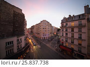 Купить «PARIS, FRANCE - SEP 09, 2014: The view from the window to the street Rue La Fayette in Paris in the evening, top view», фото № 25837738, снято 9 сентября 2014 г. (c) Losevsky Pavel / Фотобанк Лори