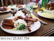 Купить «Meat ribs on plate with onions and parsley close up in cafe, Shallow dof», фото № 25837754, снято 10 мая 2015 г. (c) Losevsky Pavel / Фотобанк Лори