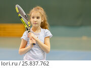 Купить «Half portrait of young girl tennis player holding her racket», фото № 25837762, снято 9 февраля 2015 г. (c) Losevsky Pavel / Фотобанк Лори