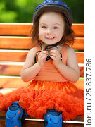 Купить «Cute little girl in blue helmet sits on bench at summer sunny day», фото № 25837786, снято 24 июня 2015 г. (c) Losevsky Pavel / Фотобанк Лори