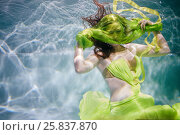 Купить «Young woman in yellow-green dress poses in swimming pool underwater with fabric above her face», фото № 25837870, снято 14 мая 2016 г. (c) Losevsky Pavel / Фотобанк Лори