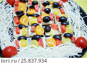 Купить «Dark dish with threads of sulguni and many tartines with pieces of olive, red fish and roma tomato», фото № 25837934, снято 21 ноября 2015 г. (c) Losevsky Pavel / Фотобанк Лори