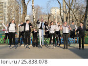 Купить «Twelve happy teenager jumping on schoolyard on sunny spring day», фото № 25838078, снято 20 марта 2015 г. (c) Losevsky Pavel / Фотобанк Лори