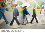 MOSCOW, RUSSIA - MAR 24, 2015: Boy (with model release) poses with Beatles iOptical Illusions Museum at VDNKh. Редакционное фото, фотограф Losevsky Pavel / Фотобанк Лори