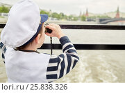 Купить «Little boy dressed as a captain looks through binoculars standing at boat stern, rear view», фото № 25838326, снято 23 мая 2015 г. (c) Losevsky Pavel / Фотобанк Лори