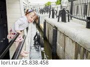 Купить «Little girl stands holding on railing at pleasure boat deck while boat approach pier», фото № 25838458, снято 23 октября 2019 г. (c) Losevsky Pavel / Фотобанк Лори