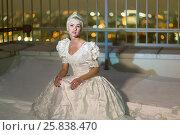 Купить «Young woman in white dress sits on snowy high-rise building roof», фото № 25838470, снято 13 февраля 2015 г. (c) Losevsky Pavel / Фотобанк Лори