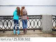 Купить «Two girls on roller skate stand on river embankment at spring day, back view», фото № 25838502, снято 5 апреля 2016 г. (c) Losevsky Pavel / Фотобанк Лори