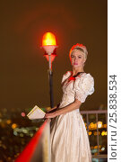 Купить «Young woman in white dress stands at roof fencing holding pile of letters in evening», фото № 25838534, снято 13 февраля 2015 г. (c) Losevsky Pavel / Фотобанк Лори