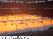 Купить «MOSCOW - DEC 25, 2014: Lamps on field in Spartak stadium at winter. New stadium is included in list of objects for games will be played at 2018 World Cup», фото № 25838542, снято 25 декабря 2014 г. (c) Losevsky Pavel / Фотобанк Лори