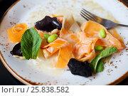 Купить «Vegetables - carrots, beans and fresh herbs - in sauce on plate and fork», фото № 25838582, снято 6 апреля 2016 г. (c) Losevsky Pavel / Фотобанк Лори