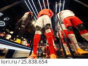 Купить «MOSCOW - DEC 25, 2014: Sport shop with football suits in Spartak stadium. Stadium capacity - 45 000 people. Stadium was built in 2010-2014», фото № 25838654, снято 25 декабря 2014 г. (c) Losevsky Pavel / Фотобанк Лори
