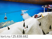 Купить «MOSCOW, RUSSIA - DEC 28, 2014: Working model of cableway in Ski slope Stepanovo. Sports complex Stepanovo is located 50 km from Moscow.», фото № 25838682, снято 28 декабря 2014 г. (c) Losevsky Pavel / Фотобанк Лори