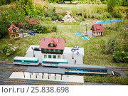 Купить «MOSCOW, RUSSIA - JUN 26, 2015: Layout of old railway station with rails, trains and buildings in Sokolniki park during festival Gardens and People», фото № 25838698, снято 26 июня 2015 г. (c) Losevsky Pavel / Фотобанк Лори