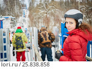 Купить «Young woman equipped for skiing near turnstile at ski resort», фото № 25838858, снято 27 декабря 2014 г. (c) Losevsky Pavel / Фотобанк Лори