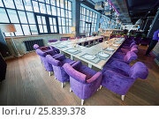 Купить «RUSSIA, MOSCOW - DEC 28, 2014: Restaurant hall, served tables with plate Reserved and soft armchairs in the restaurant Siren (Lilac), located in Sokolniki park at Pesochnaya alley», фото № 25839378, снято 28 декабря 2014 г. (c) Losevsky Pavel / Фотобанк Лори