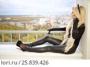 Купить «Pretty blonde woman in black cat costume sits on balcony at autumn day», фото № 25839426, снято 15 октября 2015 г. (c) Losevsky Pavel / Фотобанк Лори