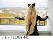 Купить «Beauty woman with long blond hair and cats ears is standing on balcony, back view», фото № 25839442, снято 15 октября 2015 г. (c) Losevsky Pavel / Фотобанк Лори