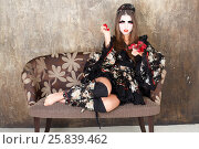 Купить «Girl in kimono and traditional Japanise makeup sitting with roses in hands studio shot», фото № 25839462, снято 17 ноября 2014 г. (c) Losevsky Pavel / Фотобанк Лори
