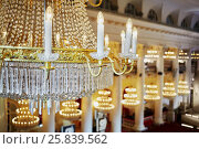Купить «Closeup chandelier with electrical candles in the hall with columns», фото № 25839562, снято 23 апреля 2016 г. (c) Losevsky Pavel / Фотобанк Лори