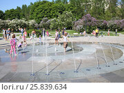 Купить «MOSCOW - MAY 25, 2015: People around the dry fountain in Lilac garden with flowering shrubs in Moscow», фото № 25839634, снято 25 мая 2015 г. (c) Losevsky Pavel / Фотобанк Лори