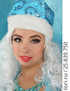 Купить «Portrait of beautiful Snow Maiden with white curly hair and cap», фото № 25839750, снято 22 ноября 2014 г. (c) Losevsky Pavel / Фотобанк Лори