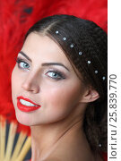 Купить «Portrait of beautiful woman in a red dress with a red fan in hand», фото № 25839770, снято 22 ноября 2014 г. (c) Losevsky Pavel / Фотобанк Лори
