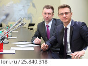 Купить «Portrait of two businessmen at negotiating table in conference hall», фото № 25840318, снято 10 апреля 2014 г. (c) Losevsky Pavel / Фотобанк Лори