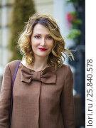 Купить «Beautiful middleaged woman in jacket walks on street and smiles, shallow dof», фото № 25840578, снято 12 июля 2015 г. (c) Losevsky Pavel / Фотобанк Лори