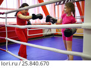 Купить «Mother and daughter train to boxing in ring in fitness center», фото № 25840670, снято 20 апреля 2015 г. (c) Losevsky Pavel / Фотобанк Лори