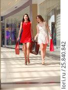 Купить «Two beautiful girls in short dresses go with bags in shopping center», фото № 25840842, снято 21 апреля 2015 г. (c) Losevsky Pavel / Фотобанк Лори