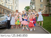 Купить «Group of eleven children and four woman stands posing at sidewalk», фото № 25840850, снято 29 мая 2016 г. (c) Losevsky Pavel / Фотобанк Лори