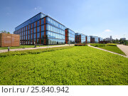 MOSCOW - JUN 03, 2015: Business center Olympia Park and lawn. Olympia Park complex has offices, sports complex and park. Редакционное фото, фотограф Losevsky Pavel / Фотобанк Лори