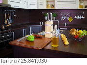 Купить «Empty kitchen with brown table with bread, oil, fruits, sink, modern stove», фото № 25841030, снято 4 июня 2015 г. (c) Losevsky Pavel / Фотобанк Лори