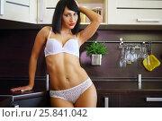 Купить «Pretty woman in white underwear poses near table in modern kitchen», фото № 25841042, снято 4 июня 2015 г. (c) Losevsky Pavel / Фотобанк Лори