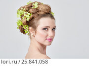 Купить «Close-up portrait of young woman with hairdress with green petals braided», фото № 25841058, снято 11 января 2015 г. (c) Losevsky Pavel / Фотобанк Лори