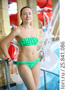 Купить «Portrait of wet young woman in a green bikini by the pool at the aquapark», фото № 25841086, снято 28 февраля 2015 г. (c) Losevsky Pavel / Фотобанк Лори