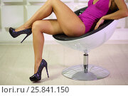 Купить «Woman in bodysuit and shoes with heels sits on white chair in studio, noface», фото № 25841150, снято 4 июня 2015 г. (c) Losevsky Pavel / Фотобанк Лори
