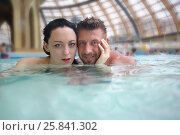 Купить «Man and woman swimming in the pool at the aquapark», фото № 25841302, снято 28 февраля 2015 г. (c) Losevsky Pavel / Фотобанк Лори