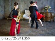 Купить «Dancer spins woman next to girl playing saxophone in retro room», фото № 25841350, снято 4 июня 2015 г. (c) Losevsky Pavel / Фотобанк Лори