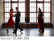 Купить «Girl plays sax and beautiful couple dance tango near big window», фото № 25841354, снято 4 июня 2015 г. (c) Losevsky Pavel / Фотобанк Лори