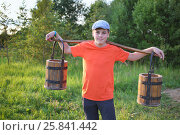 Купить «Portrait of a young boy in a cap with a yoke and wooden pails», фото № 25841442, снято 18 июля 2015 г. (c) Losevsky Pavel / Фотобанк Лори