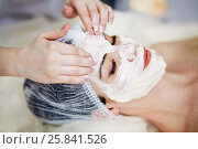 Купить «Beautician smears cosmetic mask with hands on face of woman lies on couch in beauty salon», фото № 25841526, снято 1 марта 2015 г. (c) Losevsky Pavel / Фотобанк Лори
