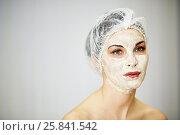 Купить «Portrait of woman with cosmetic mask on face and mesh hair cap on head», фото № 25841542, снято 1 марта 2015 г. (c) Losevsky Pavel / Фотобанк Лори