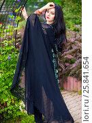 Купить «Brunette woman in black sari and Indian adornment walks in summer park», фото № 25841654, снято 19 июля 2015 г. (c) Losevsky Pavel / Фотобанк Лори