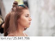 Купить «Head in profile of young woman while visagist makes hairdo», фото № 25841706, снято 10 июня 2016 г. (c) Losevsky Pavel / Фотобанк Лори