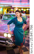 Купить «Woman in retro dress in bar touching pink car», фото № 25841766, снято 18 января 2015 г. (c) Losevsky Pavel / Фотобанк Лори
